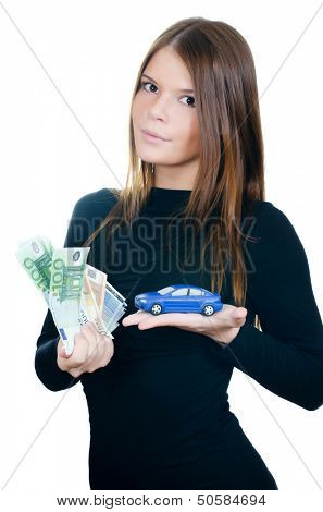 Beautiful woman with money and toy car