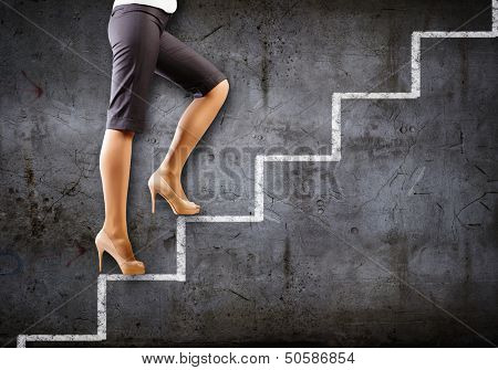 Image of businesswoman climbing career ladder. Success and achievement