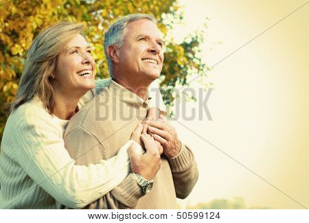 Happy senior couple relaxing in the park.