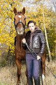 equestrian with her horse in autumn poster