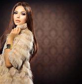 Beauty Fashion Model Girl in Fox Fur Coat. Beautiful Woman in Luxury Red Fur Jacket  poster