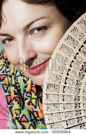 Beautiful Smiling Woman With A Fan