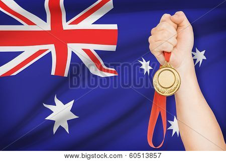 Medal In Hand With Flag On Background - Australia