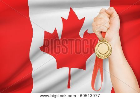 Medal In Hand With Flag On Background - Canada