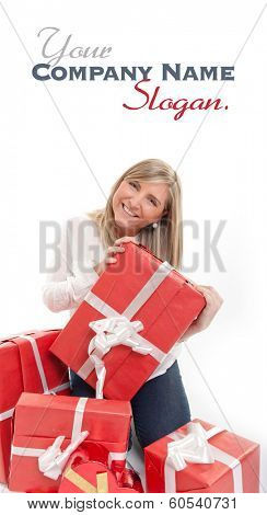 Happy young blonde in the process of receiving lots of red presents