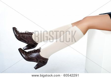 Models legs wearing fashion shoes with crocodile skin pattern