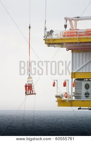 poster of Workers are lifted by the crane to the offshore platform, Transfer crews by personal basket from the platform to crews boat