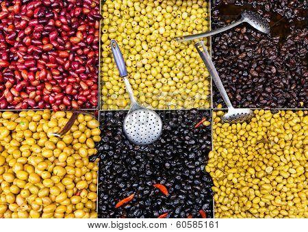 Racks with olives at Mahane Yehuda, famous market in Jerusalem