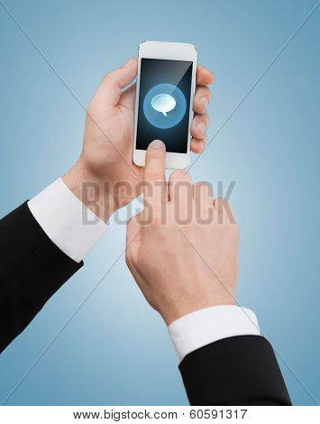 business, internet and technology concept - businessman touching screen of smartphone with text bubble