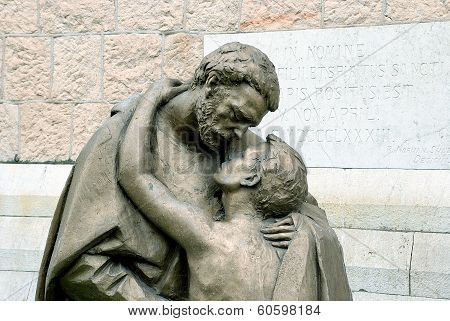 Detail of Sculptures Return of the prodigal son in front Catholic Church