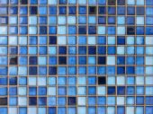 Close up of little square tiles in various shades of blue poster