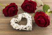 roses as a gift and surprise to a party. symbolic photo for birthday, mother's day, love, valentine's day poster