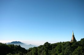 Landscape Pagodas Mountains Mist Clouds And Sky