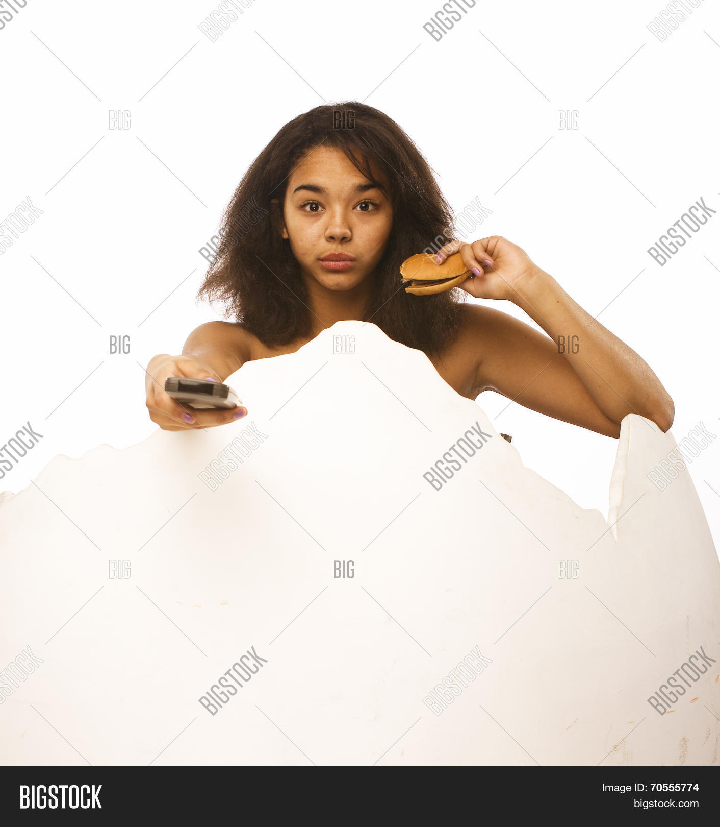 young fat african american teen girl with remote and hamburger isolated,  unhealthy obsessed