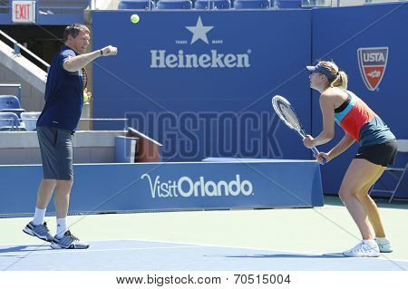 Four times Grand Slam champion Maria Sharapova practices with her coach Sven Groeneveld for US Open