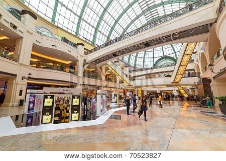 DUBAI, UAE - 3 APRIL 2014: People walking in Mall of the Emirates in Dubai, UAE. Mall of the Emirates is multi-level shopping centre with over 700 stores and Ski Dubai - first indoor ski resort.