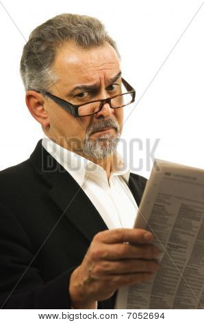 Businessman Wearing Glasses Holds A Newspaper.