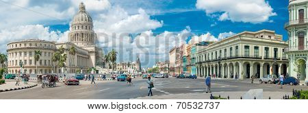 HAVANA,CUBA - MARCH 17, 2014 : Street scene with people and old cars next to the Capitol buildiing in Old Havana