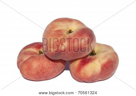 Flat peaches on a white background