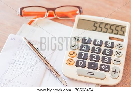 Work Station With Calculator, Pen And Eyeglasses