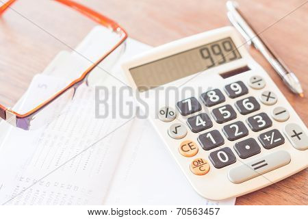 Bank Account Passbook With Pen, Calculator And Eyeglasses