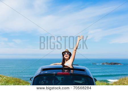 Woman On Car Vacation Travel Waving