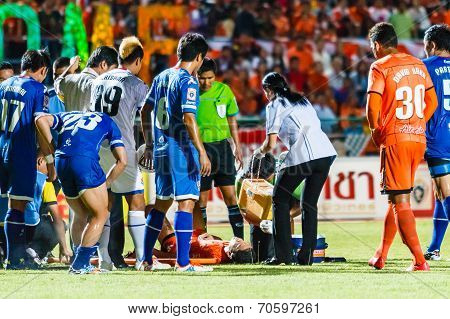 Sisaket Thailand-august 13: First Aid Team Of Sisaket Fc. (white) In Action During Thai Premier Leag