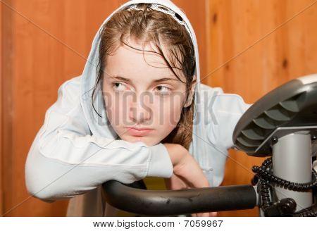 Weariness Girl On Exercycle