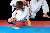 Strong sportsmen in  judogi are doing throws poster