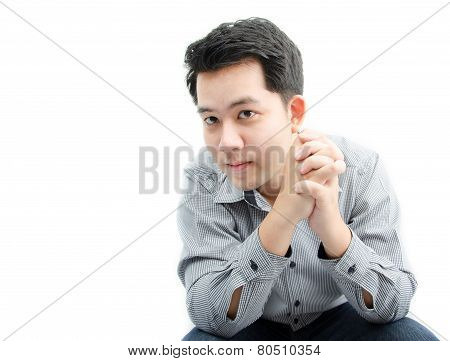 Portriat Of Young Man Sittting On White Background