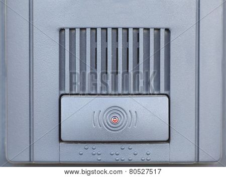 Close - up at Security intercom button in the apartment door