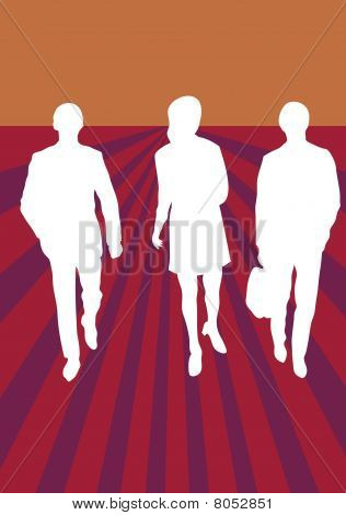 Three business people walking forward