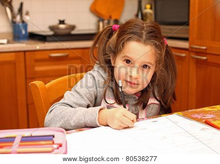 Girl Writes On The Notebook Of Schoolwork