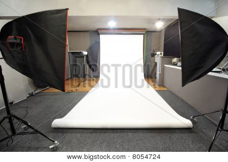 Interior Of Professional Photo Studio With White Background
