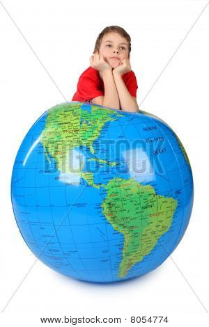 Boy In Red Shirt Leans On Inflatable Globe Chin On Hands  Isolated On White
