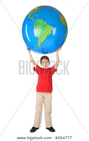 Boy In Red Shirt Smiling And Holding Big Inflatable Globe Over His Head Isolated