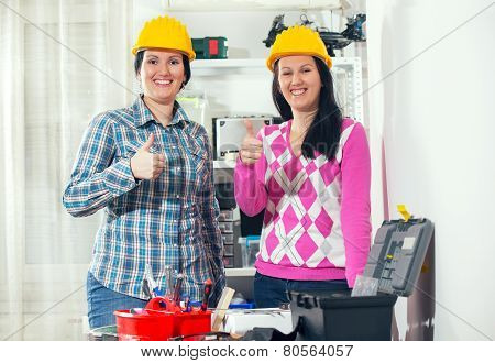 Craftswomen showing thumbs up in the workshop