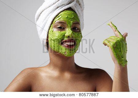 Woman Wearing A Towel And Avacado Facial Mask
