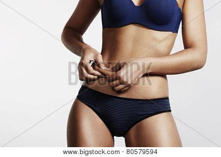 Women Pinch A Fat On Her Abdomen