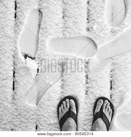 Closeup Of The Bare Feet Of An Old Man In Slippers On New Front Porch Winter Snow