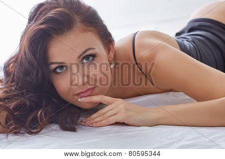 Image of gray-eyed temptress looking at camera