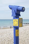 Blue painted Talking Telescope on the beach at Bognor Regis. West Sussex. England poster