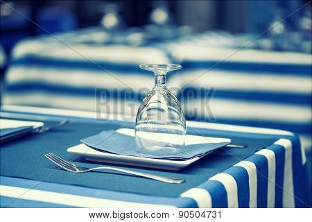 Retro styled photo of glasses on a dining table  - sailor styled terrace