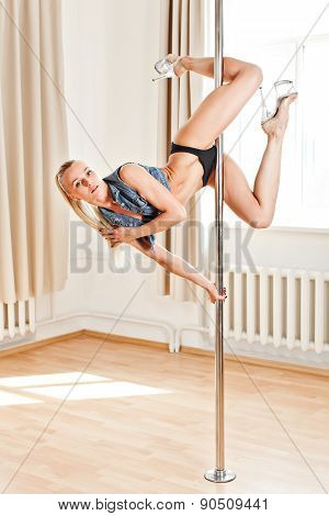 Young Slim Pole Dance Woman Holding A Pose