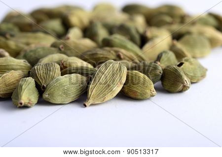 Close up of Cardamom pods on white background poster