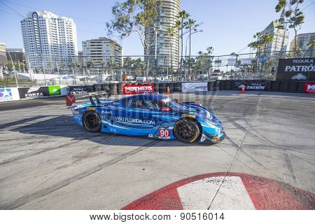 Long Beach, CA - Apr 17, 2015:  The Spirit of Daytona Corvette DP Prototype races through the turns at Toyota Grand Prix of Long Beach at Long Beach Grand Prix in Long Beach, CA.
