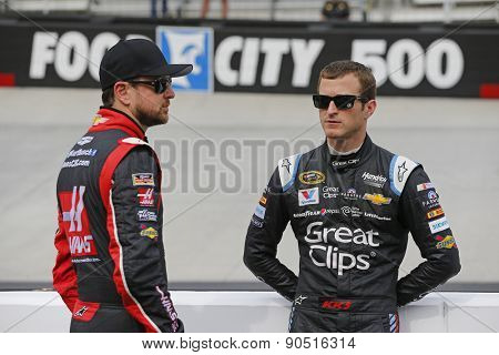 Bristol, TN - Apr 17, 2015:  Kurt Busch (41) and Kasey Kahne (5) talk during a practice session for the Food City 500 at Bristol Motor Speedway in Bristol, TN.