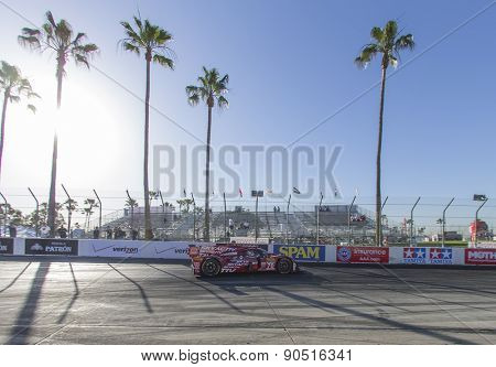 Long Beach, CA - Apr 17, 2015:  The SpeedSource Mazda Prototype,races through the turns at Toyota Grand Prix of Long Beach at Long Beach Grand Prix in Long Beach, CA.