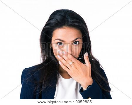 Attractive businesswoman covering her mouth with hands and looking at camera. Isolated over white background