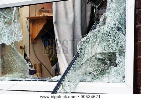 Broken security glass in building window.